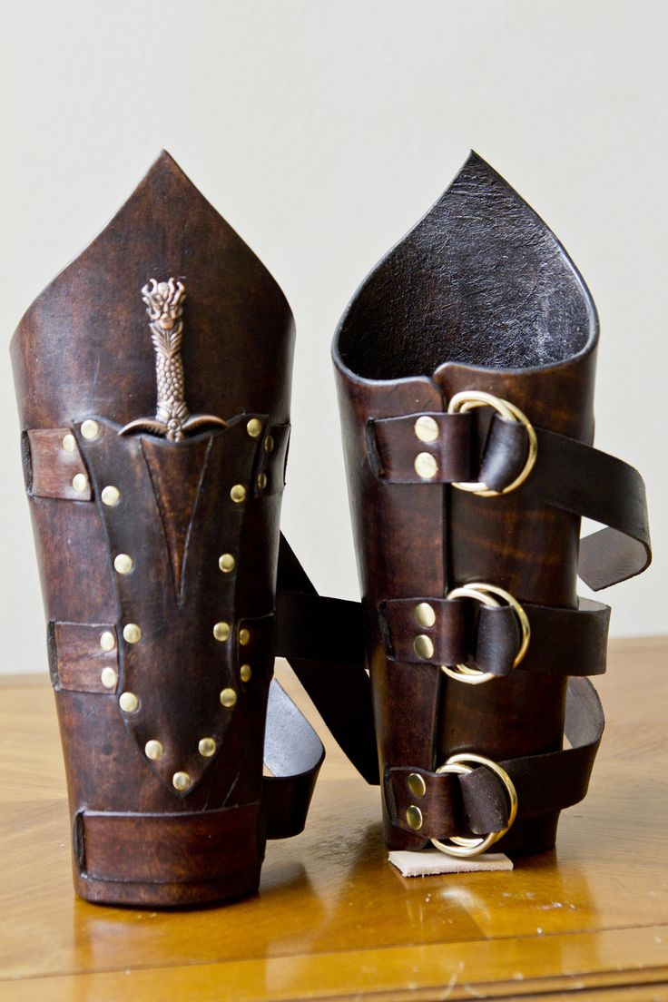 Elaborate bracers held closed with three leather belt strips, includes small dagger in a riveted pocket. Available in any color. - if anyone ever wants to buy me these, I'd be more than okay with that. ;)
