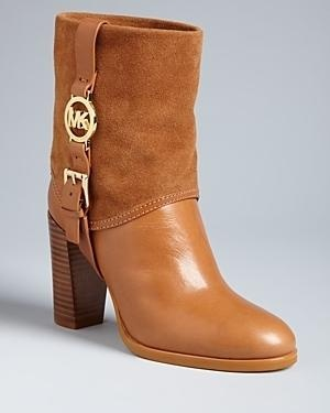 Michael Kors design, with polished leather and soft suede topped off with bold, gold, logo-accented buckles.