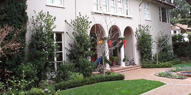 This 1920s Spanish-style home was victim to poorly panned additions resulting in an incohesive and dark space. Led by Principals, Michael Booth and Dorothy Greene, the design team from San Francisco-based BAMO turned this property into a bright, warm and elegant home with a sense of style reminiscent of a Montecito estate. The exterior of this home was swathed in soft pink.  - Veranda.com