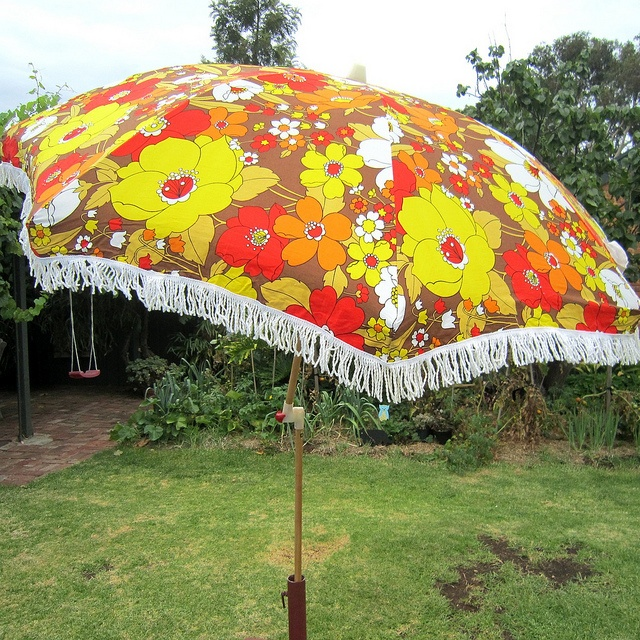 floral beach umbrella - kind of want one of those now LOL