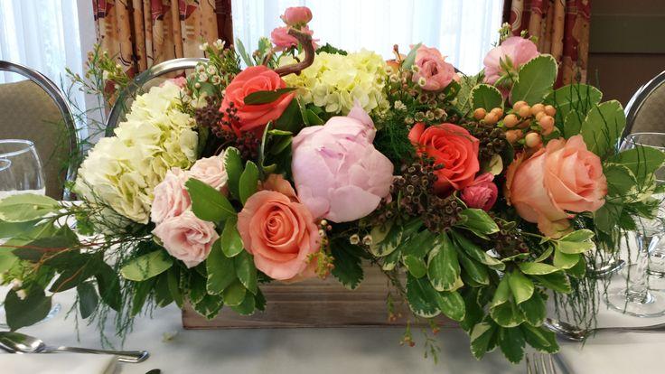 Hydrangeas, peonies, roses, spray roses, hypericum, pittosporum, ruscus, ranunculus.