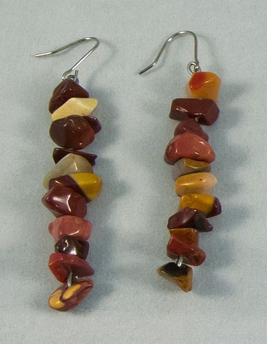 These gorgeous earrings are a mix of yellow opal arranged in a line. They measure at 5 cm.