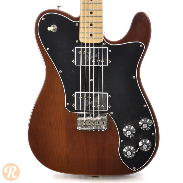 Fender '72 Telecaster Deluxe 2005 Walnut   The '72 Telecaster Deluxe is a reissue Telecaster made in Fender's Mexico factory as oart of the Classic Series. It features two humbuckers and the large-style headstock of the '70s.