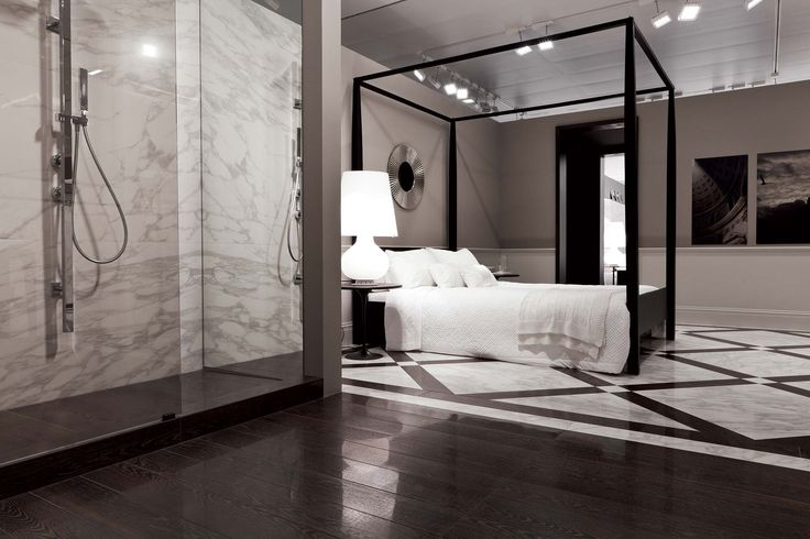 "Ceramic polished porcelain tiles for elegance: Rex Gallery showroom contrasting ""wood"" inlay trim around ""marble"""
