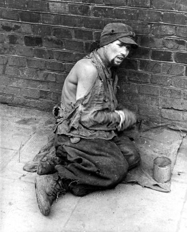 Name: Warsaw, Poland, An exhausted Jew dressed in rags in a ghetto street.  Belongs to collection: Yad Vashem Photo Archive  Origin: Alexander Bernfas
