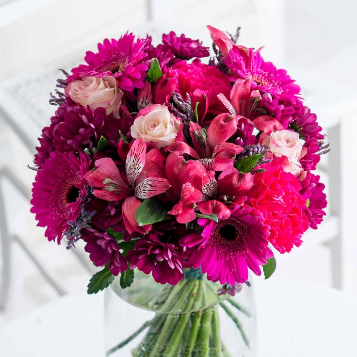 Rosy Glow: A sumptuous collection of blooms in beautiful pink tones make up our Rosy Glow bouquet - the perfect way to bring Autumnal warmth into the home of your loved one.