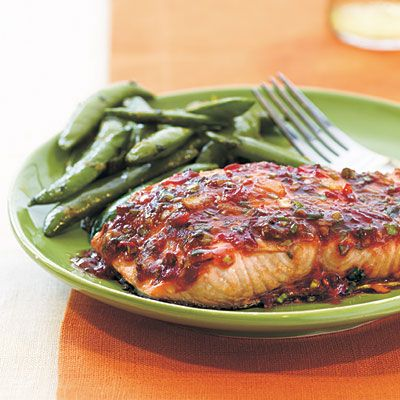 Chili-Garlic Glazed Salmon    This sweet-and-spicy glaze permeates the fish as it broils, creating an intensely satisfying entrée with only 298 calories per serving. Minted Sugar Snap Peas make a cool, complementary side.    Pantry Checklist:    Salmon fillets (4 6-oz)  Chili sauce with garlic  Green onions  Low-sugar orange marmalade  Low-sodium soy sauce  Prep: 4 minutes  Cook: 7 minutes