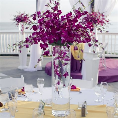 Tall cylinders filled with submerged tulips, roses and orchids were set in a bed of purple flowers and greens. Description from pinterest.com. I searched for this on bing.com/images