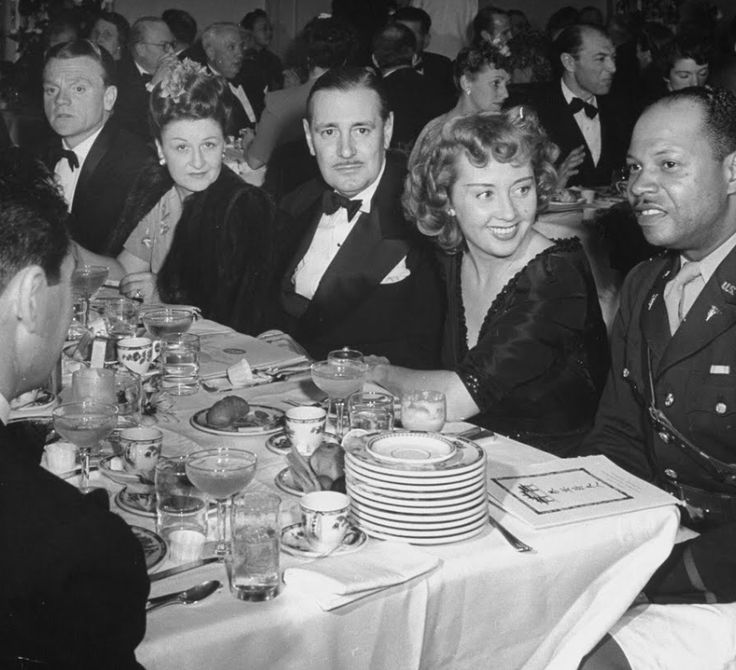Mr. and Mrs. James Cagney, Kenneth Thompson, Joan Blondell, and Lt. S. W. Booker, attending the party for Madame Chiang Kai-Shek, 1943