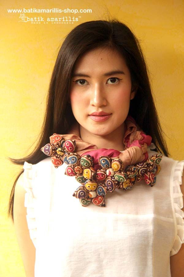 Batik Amarillis's Blooming forever Scarf AVAILABLE at www.batikamarilli... batik amarillis's blooming forever scarf Gorgeous ,unique and special Blooming forever scarf it's made of various flowy fabrics with hand made 6 flowers made of various Indonesia's traditional Textiles such as Batik and Ikat . can be tied and styled in many ways.