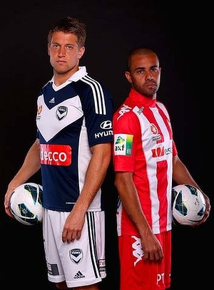 MELBOURNE, AUSTRALIA - OCTOBER 02:  Adrian Leijer of the Melbourne Victory and Fred of Melbourne Heart pose during a 2012/13 A-League player portrait session at AAMI Park on October 2, 2012 in Melbourne, Australia.  (Photo by Quinn Rooney/Getty Images)