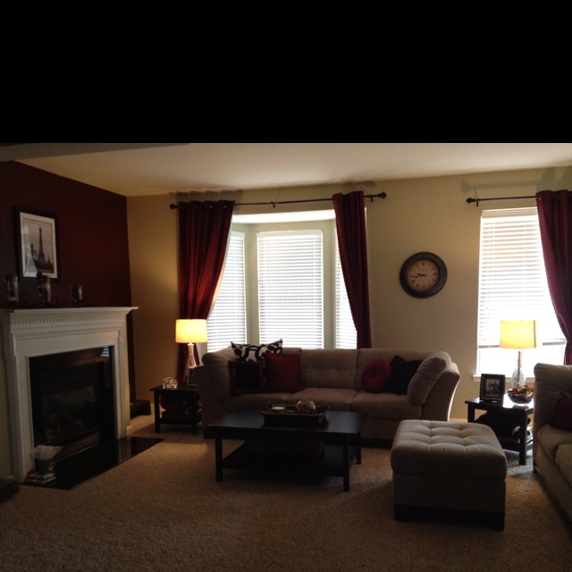 Simply formal living room.  Black and white picture with black and maroon accent pillows.