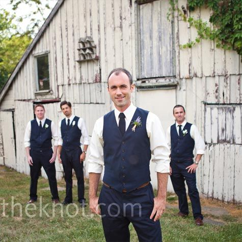 The groom and groomsmen dressed like this -Groomsmen in black slacks and vest with horizon blue tie and Steve (the groom) will be the same but with a lighter blue tie