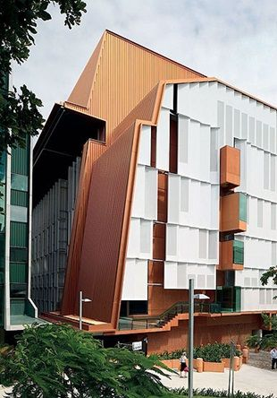 Translational Research Institute, Brisbane, Australia | Pedestrian connections enhance access for TRI and hospital campus workers. The wall cladding made from COLORBOND® Metallic steel in the colour Copper Penny, in Stramit Speed Deck Ultra® profile, provides a textural and tonal contrast with the recycled bricks and rose glass