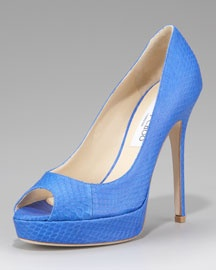Bright color, peep toe to show off a great pedi, and a sky-high heel. Perfect!
