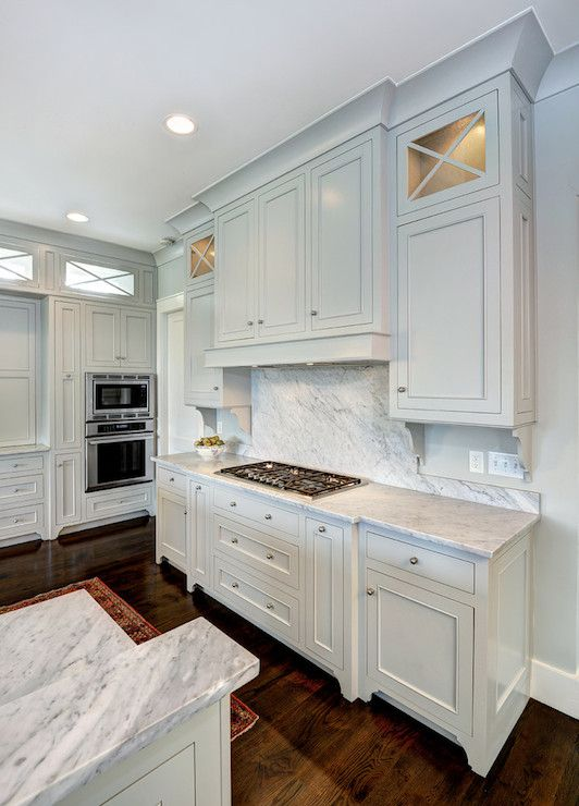 Gray Owl by Benjamin Moore on cabinets and wall.  looks ok with the marble.
