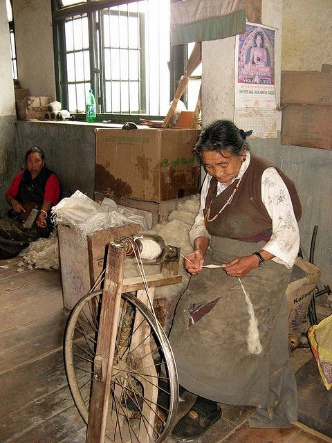 Tibetian lady spinning - At the Tibetan refugee center in Darjeeling. Most of the residents there are older now, not many younger ones willing to stay and learn the old crafts