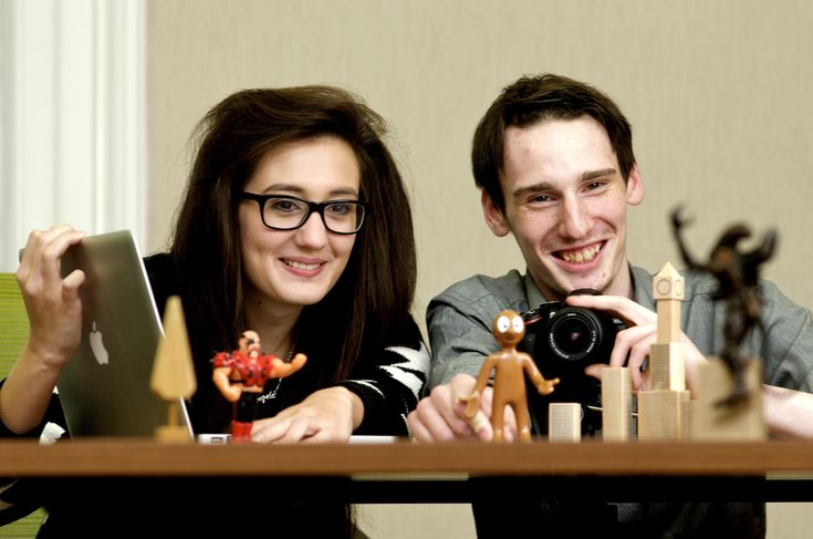 Two students creating a stop motion animation.