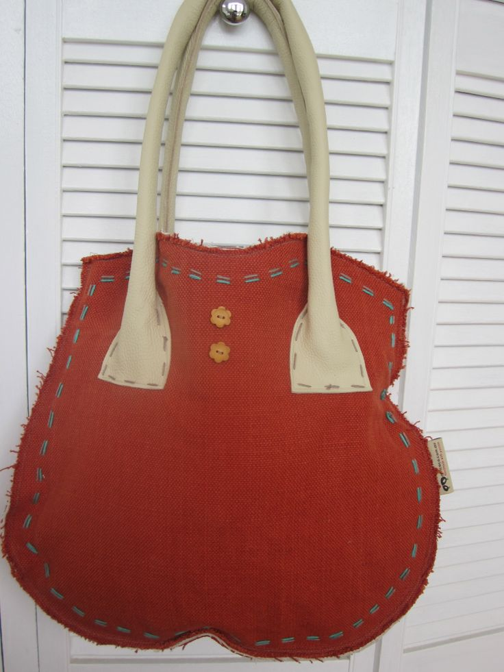 Red/orange heavy fabric from India, with cream leather handles