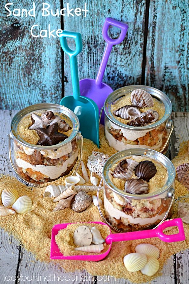 This Sand Bucket Cake is a play on your favorite vacation trip to the beach.  Filled with Cinnamon Swirl Crumb Cake and Cinnamon Frosting. Lady Behind The Curtain