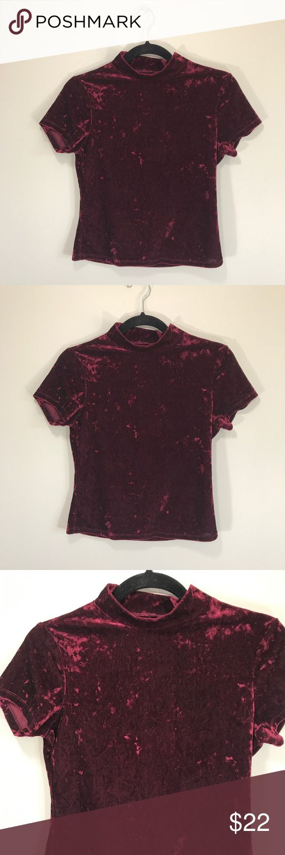 """Vintage 90s Burgundy Crushed Velvet Mock Neck Top In excellent vintage condition. Super soft outer velvet shell. High neck. Short sleeve. Stretchy! No Tags or size tags. Approximately size small. Please refer to measurements to ensure a proper fit! Pit to pit: 16"""" Length: 20"""" Tops Blouses"""