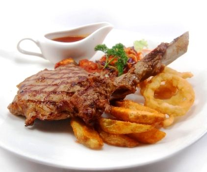 CALIFORNIAN VEAL RIBS. Tender & juicy grilled veal, served with potato wedges, ratatouille, onion ring & coleslaw, in a smoky BBQ sauce.
