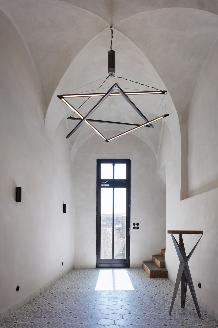 In transforming a 16th century-Czech Republic residence into this guesthouse, local studio ORA celebrated an assortment of original details including old plasterwork, semi-circular windows and stone steps.