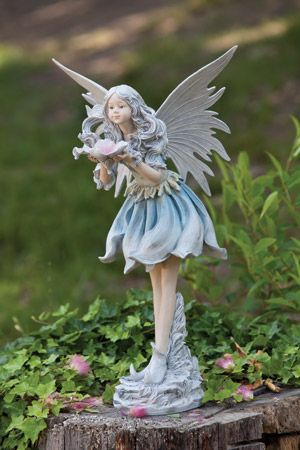 Good This Wishful Fairy Statue Will Bring Loveliness To Your Garden Or Home With  The Purity Throughout Her Poise. Her Soft Blue Dress And Pink Flower She  Gently ...