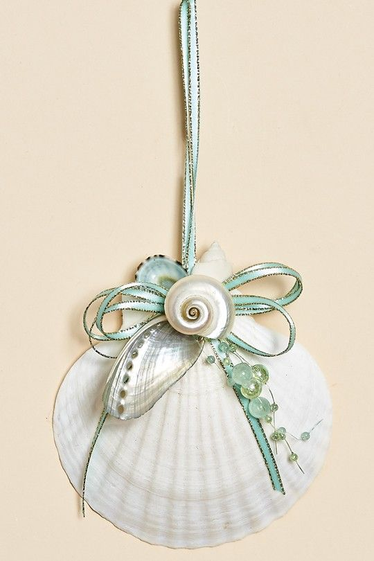 Set of Three - 4 inch Natural Baking Dish with white and aqua shells, aqua beads and an aqua satin bow with gold edge. These decorated baking dish shells make a perfect ornament or may be hung on the
