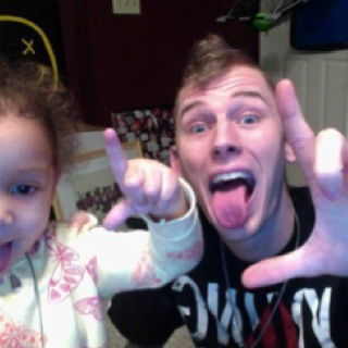 Machine Gun Kelly and his daughter, Casie. Lace up!