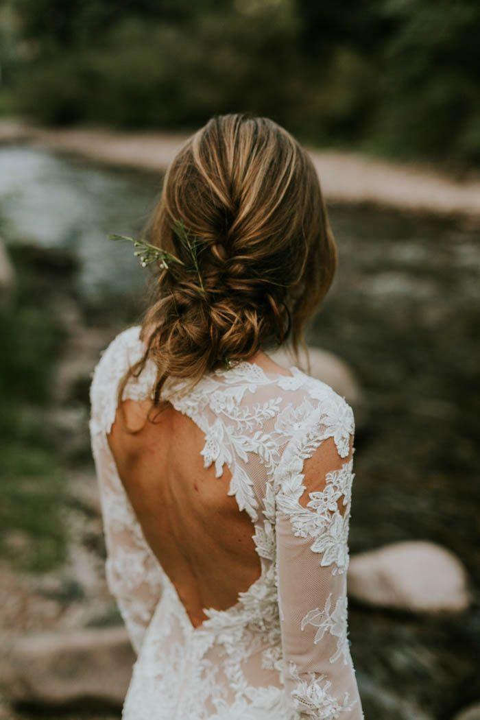 Open back Ines Di Santo lace wedding gown + messy braid | Image by Joel Bedford Weddings