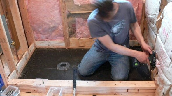 """Build a shower curb frame using stacked 2 x 4s.  Add blocking between wall studs to """"form"""" shower pan box."""