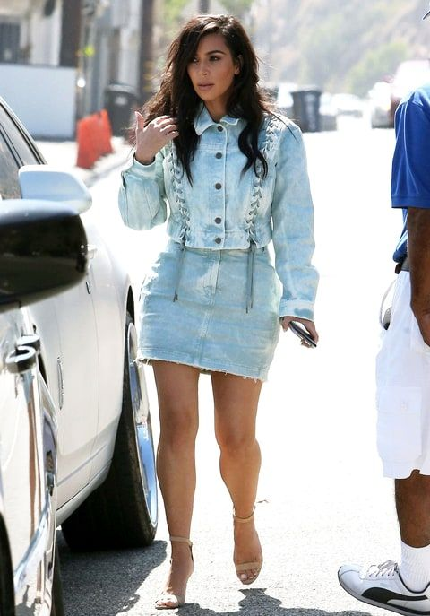 Kim Kardashian gave off major 80s vibes in her acid washed denim on denim outfit! See the pics!