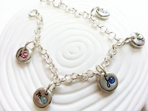 Hand stamped and personalized with your initials and birthstones, this charm bracelet is made of cast pewter charms, set with Swarovski crystal birthstones. Please select the number of charms you would like from the drop down menu, as the number of charms will set the listing price for you. I can also use any of the images from my Design Charms section of my shop as charms on this bracelet. The charms measure 3/8 (10mm) each and are made from cast pewter. They have a soft, organic shape, and…
