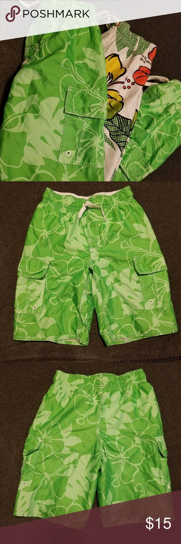 Old Navy Boys Swim Trunk Lot This listing includes 3 pairs of Old Navy boys swim trunks. 2 pairs - green. 1 pair - white with green and orange flowers. All are boys size medium (8). GUC Old Navy Swim Swim Trunks