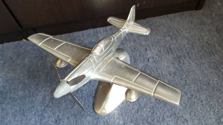 Cast aluminium model of a Mustand P51 on integrated stand  (remodeled nosecone and propeller) by FromDECOtoDISCO on Etsy