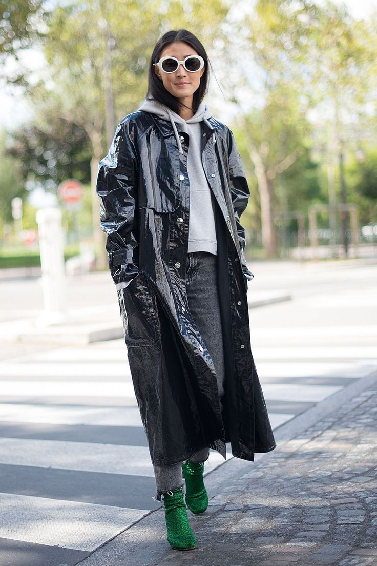 13 Ways To Wear Winter's Patent Leather/Gloss Trend #refinery29  http://www.refinery29.uk/patent-vinyl-gloss-trend-aw16#slide-13  Third time's a charm. Hong Kong fashion editor Justine Lee in the Isabel Marant coat, cropped hoodie, Vetements shoes and frayed jeans. We love how the hoodie and sunglasses completely change the coat from the way it was worn by Pernille....