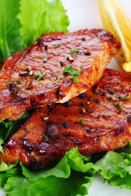 Grilled Pork Steaks with Lemon Butter Sauce ~Here's a simple recipe for pork steaks or chops. All you do is baste the meat with a sauce that consists of butter, lemon juice and garlic. Very basic, and the chops will be moist and tasty