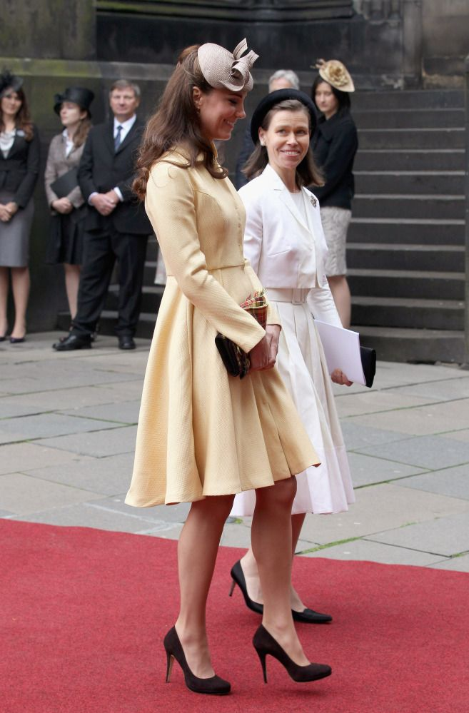Catherine In A Pale Yellow Coat Dress