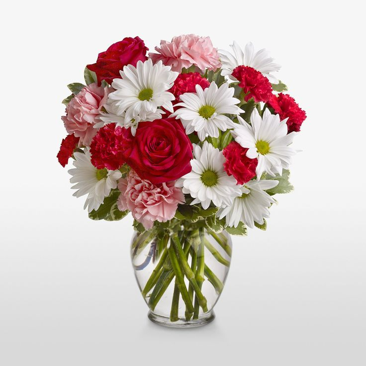 A simple yet gorgeous #Holiday arrangement. #Red&WhiteBouquet #ChristmasBouquet