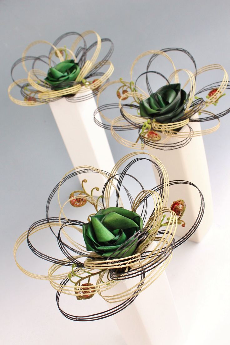 Single flower bouquets with a flax flower and three koru by Flaxation