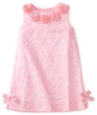 Her Lilly Pulitzer dress. It has cake embroidered in white.