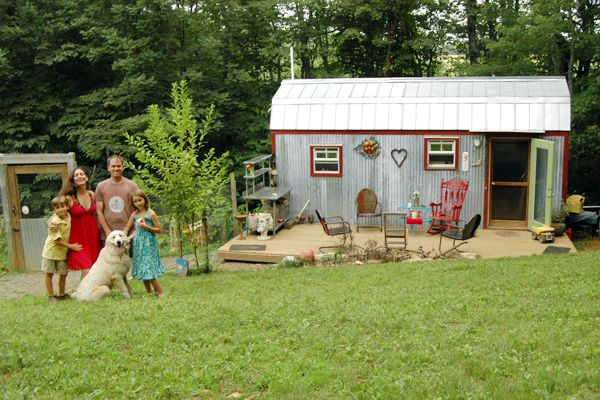 The Berzins family outside their tiny home. Could you live in 320 square feet?
