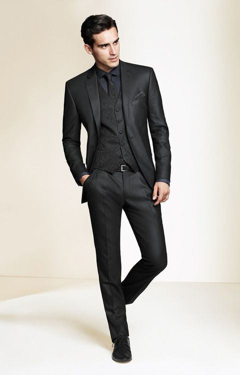 Shop+this+look+on+Lookastic:  http://lookastic.com/men/looks/dress-shirt-tie-pocket-square-waistcoat-belt-suit-derby-shoes/9209  —+Charcoal+Dress+Shirt+ —+Black+Tie+ —+Black+Pocket+Square+ —+Black+Print+Waistcoat+ —+Black+Leather+Belt+ —+Black+Suit+ —+Black+Leather+Derby+Shoes+