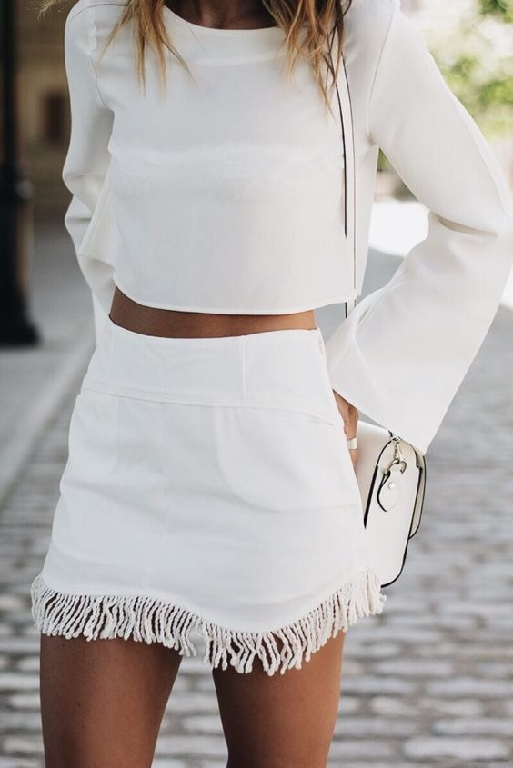 all white. minimal street style. crop top. fringe mini skirt.