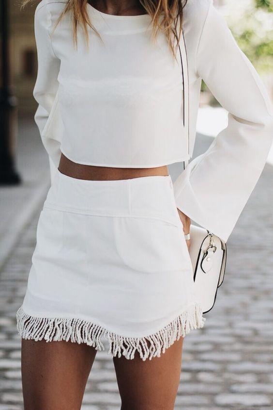 all white. minimal street style. crop top. fringe mini skirt.