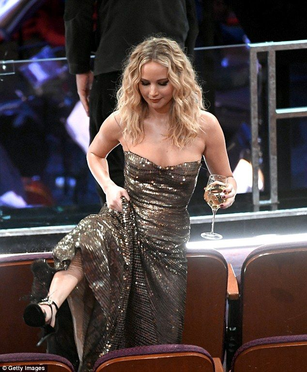 Hamming it up: Jennifer Lawrence let loose at Sunday's 90th Annual Academy Awards as she struggled to find her seat