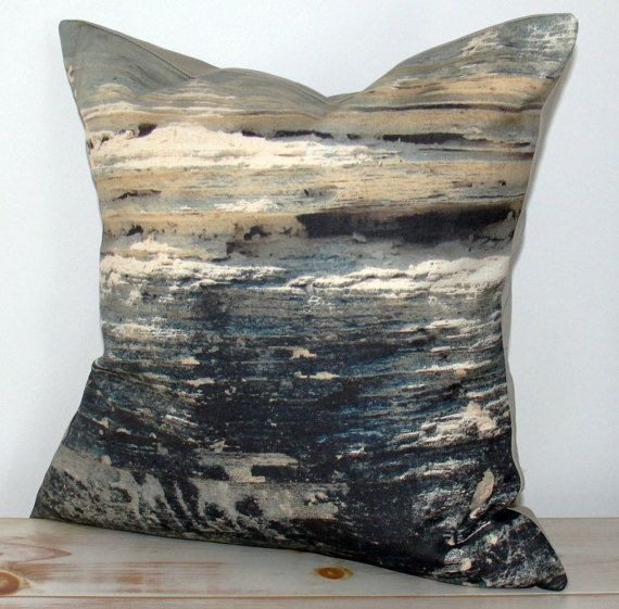 Decorative designer cushion inspired by natural stone cliffs on Caribbean sea shore.