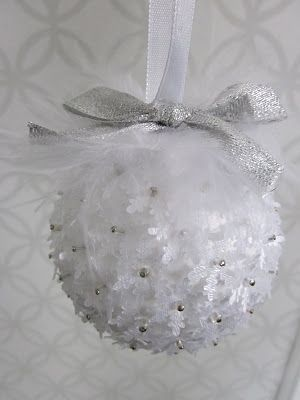 DIY Christmas Ornament-  styrofoam balls, beads, little fabric snowflakes, feathers and ribbon for the tops.
