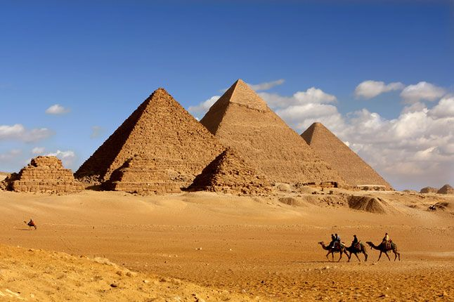 See the Great Pyramids of Giza and the Sphinx